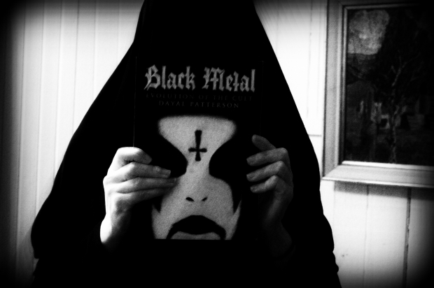 Holding my copy of Black Metal: Evolution of the Cult.