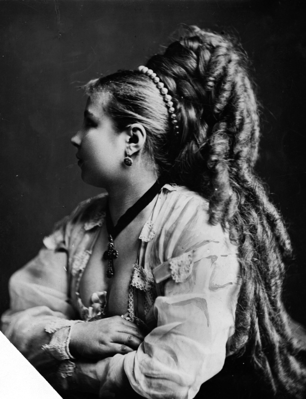 circa 1870:  A woman with a locks of hair carefully curled and falling down her back.  (Photo by Hulton Archive/Getty Images)