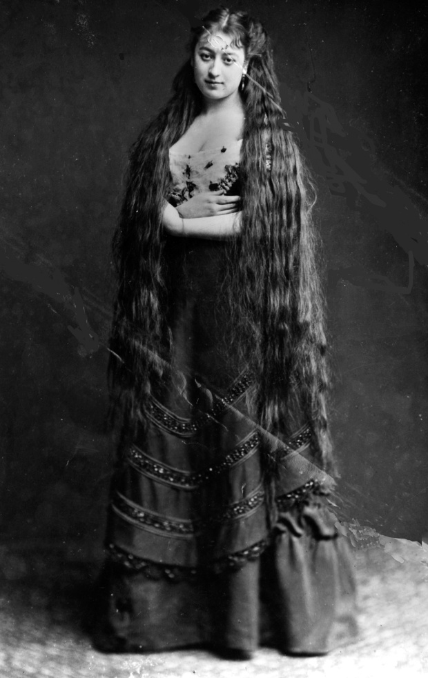 circa 1890:  Mrs Frampton proudly displays her very long hair.  (Photo by Hulton Archive/Getty Images)