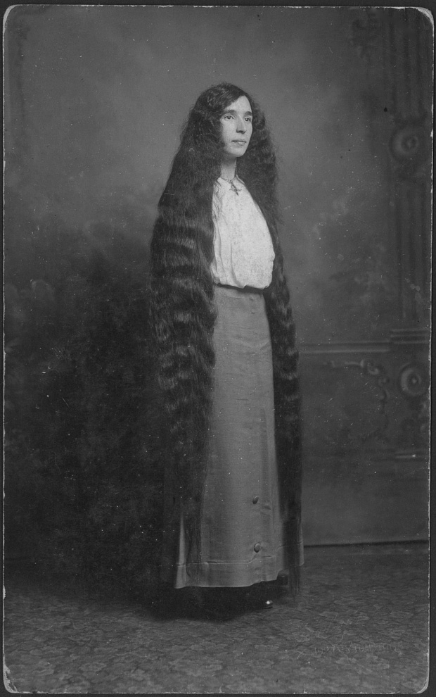 Portrait of a young woman with long hair almost to the floor, circa 1900s. (Photo by: PYMCA/UIG via Getty Images)